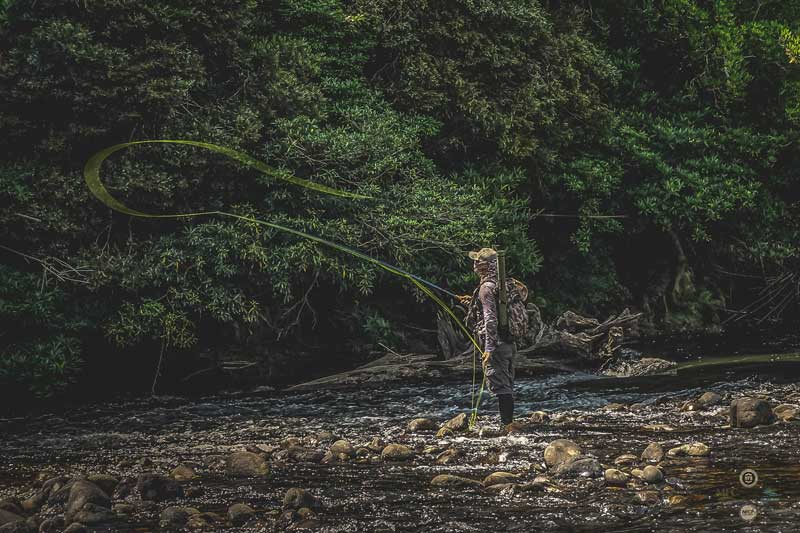 Fly fishing a rapid in Laos