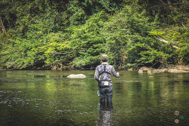 Testing the fly-fishing in a Laos river